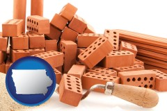 ia map icon and bricks and a trowel