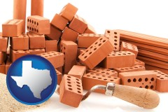 texas map icon and bricks and a trowel